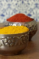 Curry and cayenne pepper in dishes