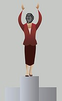Businesswoman standing on a pedestal
