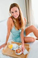 Woman with breakfast tray