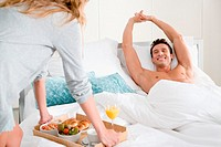 Man getting breakfast in bed