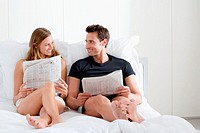 Couple with newspapers