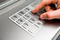Person pressing cash machine keypad (thumbnail)