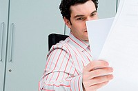 Man reading paperwork