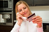 Woman telephone banking