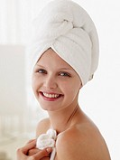 Head shot of woman with towel on head smiling