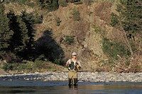 Young man fly fishing on Oldman river in southern Alberta, Canada