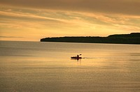 Distant kayak on Lake Superior, sunset