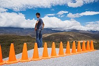 Man cornered by a row of safety cones (thumbnail)