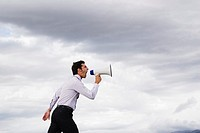 Man with megaphone shouting outdoors