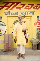 Sadhu standing in front of a store