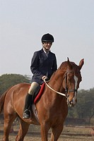 Female jockey riding a horse