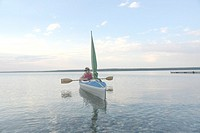 Woman in kayak Clear Lake Riding Mt Nat Park, Canada, Manitoba, Riding Mountain National Park