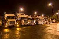 Parking lot for transport trucks at night, Canada, Ontario