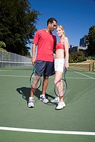 Couple on tennis court, Canada, British Columbia, Vancouver