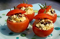 Stuffed tomato appetizer on polka-dotted turquoise plate, Canada, Ontario