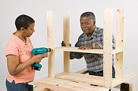 African American Couple Doing Home Improvement, Assembling a Shelving Unit, Canada, British Columbia