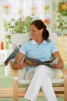 Congo African Grey parrot and woman - Psittacus erithacus