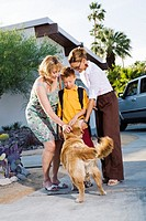 Lesbian couple petting their dog