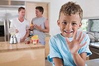 Young boy smiling on kitchen countertop