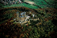 Aerial view of castle surrounded by autumn trees, Hohenzollern Castle, Swabian Alb, Baden_Wurttemberg, Germany