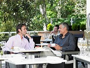 Two men talking at outdoor cafe