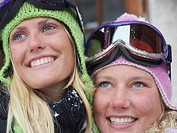 Two young blonde women in ski-wear, close-up, portrait