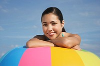 Teenage girl 16_17 sitting leaning on beach ball close up portrait