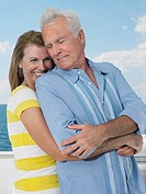 Middle_aged couple embracing on yacht