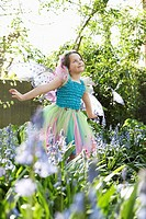 Young girl 5_6 in flower garden wearing fairy costume