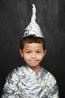 Portrait of young boy 5_6 in aluminum foil knight costume studio shot