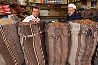 Stall in bazaar, father &amp; son, Sana'a, Yemen