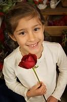 Girl holding rose