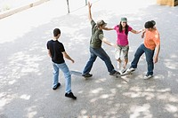 Group of teens hanging out at skate park (thumbnail)
