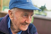 Elderly man in cap