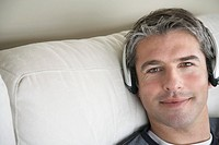 Man listening to music with earphones