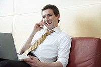 Young businessman with relaxed working style