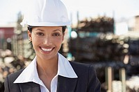 Woman in hard hat at construction site
