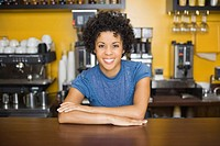 Smiling woman leaning against counter