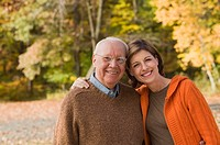 Adult daughter and father smiling in autumn