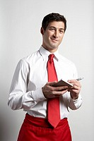 Waiter writing order on note pad, portrait