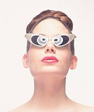 Woman wearing retro sunglasses, close-up