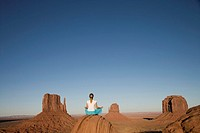 USA, Arizona, Monument Valley, Woman in yoga position, rear view