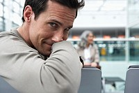 Man sitting in airport, portrait, close-up