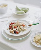 Chicken salad with celery and grapes, zucchini and couscous on side