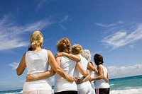 Rear view of group of senior women at beach