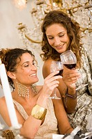 Women toasting each other with wine