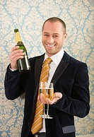 Man holding two glasses of champagne