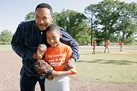 Monroeville, Veterans Park, little league baseball, Black father, son, ball, glove. Alabama. USA.