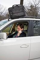 Businessman buckling his seatbelt