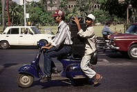 transporting music systems on scooter , bombay mumbai , maharashtra , india